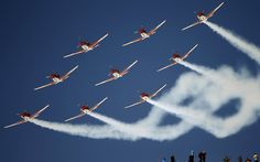 Members of the Swiss Air Force PC 7 team fly in formation over the Alpine Skiing World Cup finals in the mountain resort of St. Moritz, Switzerland