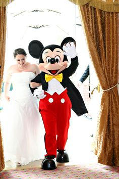 This Disney bride made an entrance with Mickey Mouse himself!