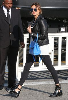 IT GIRL Style: Hailey Baldwin wearing a leather jacket with black skinny jeans and cut-out ankle boots + a cool blue leather bag