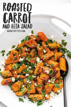 A simple an inexpensive side dish, this Roasted Carrot and Feta Salad combines sweet roasted carrots with salty feta and fresh parsley for a simple salad. BudgetBytes.com
