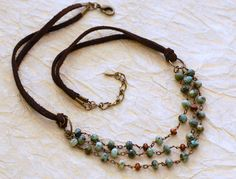 Turquoise Wire Wrapped Leather Layered Necklace. $72.00, via Etsy.