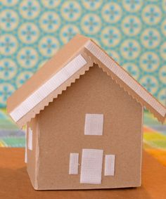 DIY cardboard gingerbread house. WITH VELCRO! Oh Valerie, you are a GENIUS!