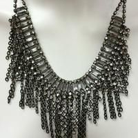 Silver chain and rhinestone statement necklace is a great piece.