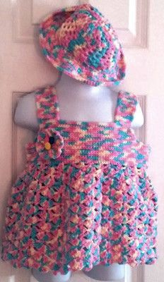 This cute little sundress outfit is accompanied by a matching sunhat and matching panties. It is hand crocheted in 100% acrylic yarn, making it machine washable and dryable for effortless care. This outfit will fit loosely on a 12 to 24 month old. Available from KidKraft Kreations Designs.