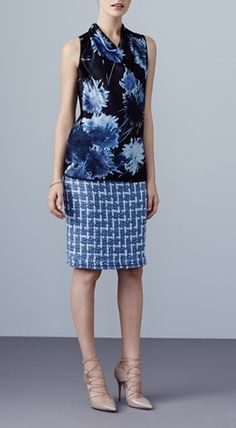 e7de892d98a8a Mix   match your office look with printed separates. Pair a floral silk  blouse with a blue geometric-print pencil skirt for an updated work look.