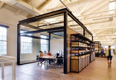Would be interesting to have meeting rooms read as boxes placed in the open floor plan- wide open as a gathering space, but able to close to hold a meeting