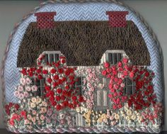 "Needlepoint tea cozy titled ""Rose Cottage""  based on an English cottage from a copy of a magazine entitled ""The English Home"":"