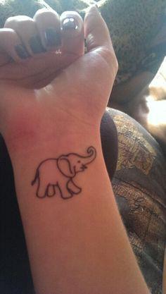 Cute elephant outline tattoo