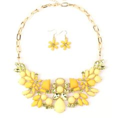 New Flowers Statement Necklace Set with Crystals and Rhinestones, Yellow Color Hugssy http://www.amazon.com/dp/B00BFGG4QM/ref=cm_sw_r_pi_dp_SYZXtb0FCG1X84NF