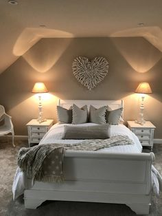 Too monochromatic for me & I don't understand the pillow mid-bed, but I do think the driftwood heart is pretty
