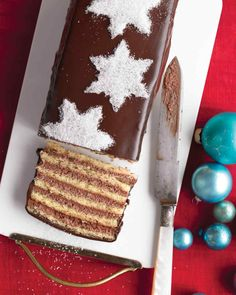 Christmas Cake Decorations That Will Dazzle and Delight | Martha Stewart Living - Powdered sugar snowflakes turn a chocolate-glazed layer cake into something worth celebrating.
