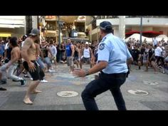 Mad Cool.. Policeman joins in with spontaneous Haka at Surfer's Paradise