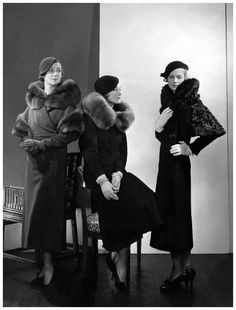 Photo Edward Steichen 1932  -  Models wearing (from left) wool coat with fur collar and armbands; wool coat with blue fox collar by Lanvin; and wool coat with caracal collar and sleeve trimming by Mainbocher.
