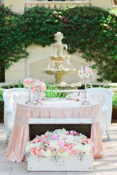 sweetheart table with a floral filled trunk