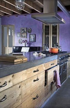 I love this kitchen! I love cement counter tops, and the purple paint is so unusual and New Orleans-ish.: