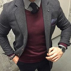 Consider wearing a charcoal wool blazer and black chinos if you're going for a neat, stylish look.   Shop this look on Lookastic: https://lookastic.com/men/looks/blazer-v-neck-sweater-dress-shirt/24019   — White and Black Gingham Dress Shirt  — Black Wool Tie  — Burgundy V-neck Sweater  — Burgundy Print Pocket Square  — Charcoal Wool Blazer  — Dark Brown Bracelet  — Dark Brown Leather Watch  — Black Chinos