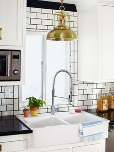 white subway tile | black grout | brass
