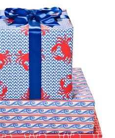 A stack of beautifully wrapped gifts featuring our Chatham & Breakers gift wrap and some gorgeous blue ribbon.