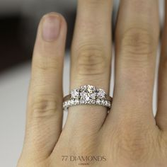 Our Roma engagement ring set with a round diamond and an eternity band as wedding band.