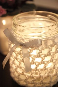 recycled jam jar as candle votive in decorative crochet cover w/ribbon accent | from Hjertero.com via Google Translate