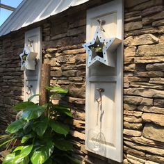 Easy idea for your porch or garden. A shutter, two hooks and then add your own accessories such as this metal star candle holder.