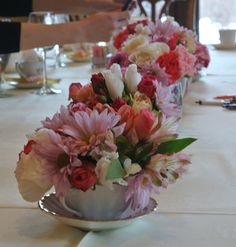 Use tea cups and tea pots as vases for flowers.