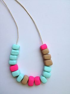 HOTEL FLAMINGO Handmade Bead Fimo Necklace - Mint and PInk. $35.00, via Etsy.