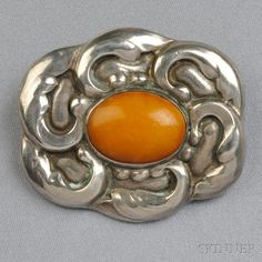 .830 Silver and Amber Brooch, Georg Jensen | Sale Number 2711B, Lot Number 176 | Skinner Auctioneers