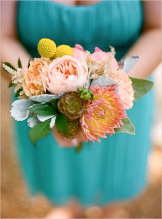 Teal bridesmaids and peach flowers