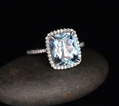 You are looking at a Stunning 14k Gold Single Cushion Halo Ring Featuring a Natural Aquamarine Cushion Cut measuring 11x9mm and surrounded with