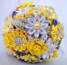 Brooch bouquet. Original handmade bridal bouquet in a silver, royal blue and yellow. Flowers made of satin ribbon, decorated with jewelry. Bouquet