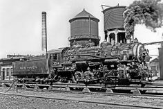 New Haven Railroad coal burning steam switcher # 3614, built by ALCO in 1927, NH class Y-4-a (3-cylinder) 0-8-0, is seen at an ash pit in an unknown railroad yard, mid 1930's, photographer unknown