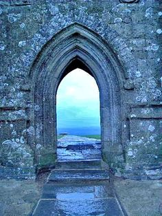 arch. stone. castle. scotland. view. sea. sky.