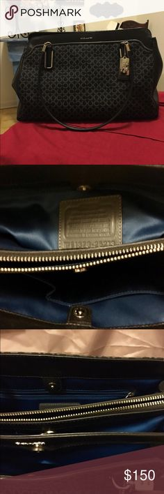 Coach Handbag Black Coach bag. Excellent condition. No stain, no wear.  Three pockets inside with middle having zipper. One roomy outside pocket w/snap. The width is 13 inches, length is 9 inches, with handles, 18 in.  Inside bag, one small zip pocket and two for cell phone or sunglasses. Silver hardware. Comes with dust bag, no box. Used twice. Very beautifully royal blue material inside..Pet free and Smoke free home... 👜 ..No Trades..👜 Coach Bags Shoulder Bags