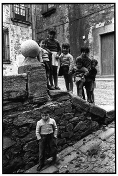 Inge Morath. Six girls and a timid boy. Caceres, Spain, 1956.
