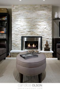 Textural Stone Fireplace • Cozy Fireplace Setting • Fireplace Stone Surround • Recessed Lighting Placement on Fireplace • #candiceolson #candiceolsondesign Fireplace Stone, Cozy Fireplace, Fireplace Design, Candice Olson, Elements Of Design, Downlights, Live Life, Family Room, Walls