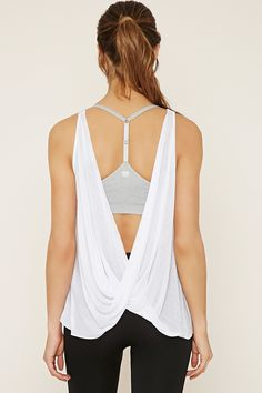 This semi-sheer knit tank features a round neckline and a draped open-back design.