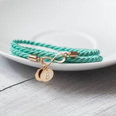 Turquoise infinity charm initial bracelet  cord rope by Folirin, $20.50