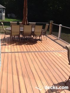 This deck has trex decking with a faux stone skirt by Exteria and real stone columns with a palight white fascia. Each column has a light on top under the column cap Deck Pictures, Decking Material, Stone Columns, Deck Builders, New Deck, Deck Plans, Building A Deck, Faux Stone, Deck Design