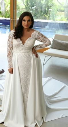 Stunning plus size lace mermaid wedding gown with long sleeves and second skirt. Milena. Studio Levana