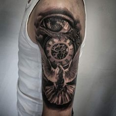 Eye clock dove tattoo Dog tattoo by Krzysztof M. Limited availability at Redemption Tattoo Studio.