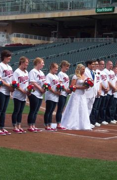 This is probably what I would do but with Red Sox!  Bridesmaids bouquets with Baseball roses