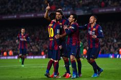 Luis Suarez of FC Barcelona celebrates with his teammates after scoring his team's fifth goal during the La Liga match between FC Barcelona and Levante UD at Camp Nou on February 15, 2015 in Barcelona, Catalonia.