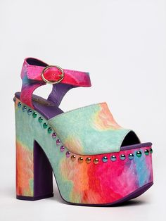 - Prepare for the sun and flawless spring weather with these sexy platform sandals! - High heels have a colorful, vegan suede upper trimmed with metallic studs and a peep toe and ankle strap. - Non-sk