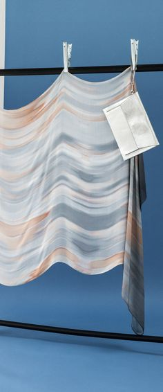 The blush pink tones of the Caramel Ombre Scarf collide with inky greys for a dramatic accessory that's soft yet striking.