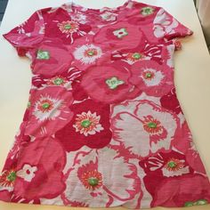 Pink Lilly Pulitzer floral top Lily Pulitzer size small. Only worn a few times and in perfect condition. Bright pink floral top perfect for spring and summer Lilly Pulitzer Tops Tees - Short Sleeve