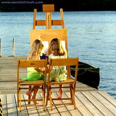 Children painting outdoors.