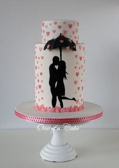 'Love is in the air '  - Just trying something new,  This is my first time using dummies and handpainting (the silhouette ) the 3D umbrella is fondant.