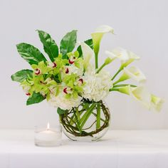 The perfect combination of white and green flowers in clear glass vase