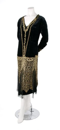 1920s Black Velvet and Gold Embroidered Evening Gown, with gold thread embroidery throughout, a V-neckline, and black chiffon panels at hem.
